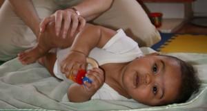baby feels proprioception of leg