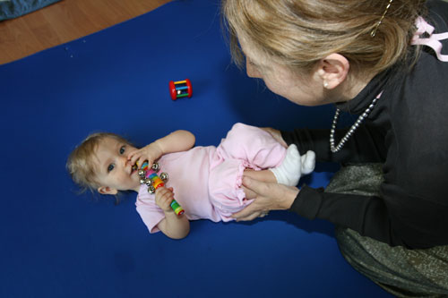 a seven month old baby demonstrates the motor skill of scooting