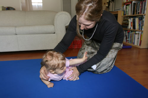 baby rolls onto her hip joints to transition to a sitting position