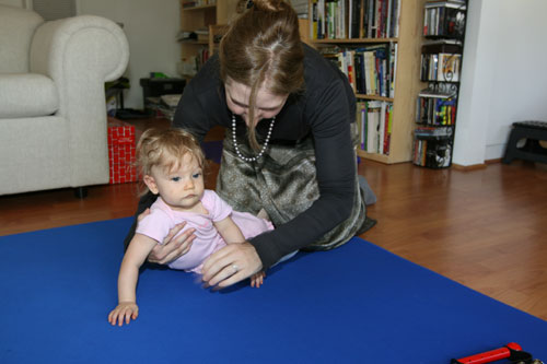 baby learns motor milestone development of transitioning from sitting to rolling