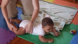 a five-month old baby enjoys tummy time