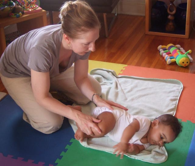 a five month old baby learn to roll onto her tummy for tummy-time