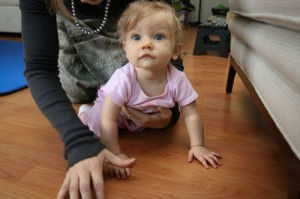 baby crawling on hands and knees