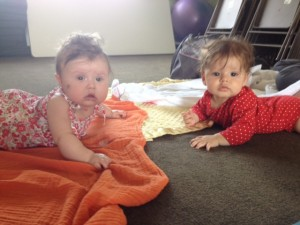 two babies enjoy tummy time