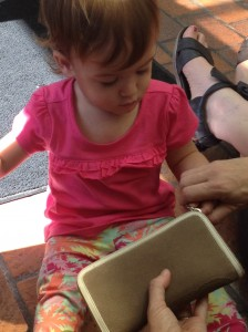 Toddler learns to pull a zipper